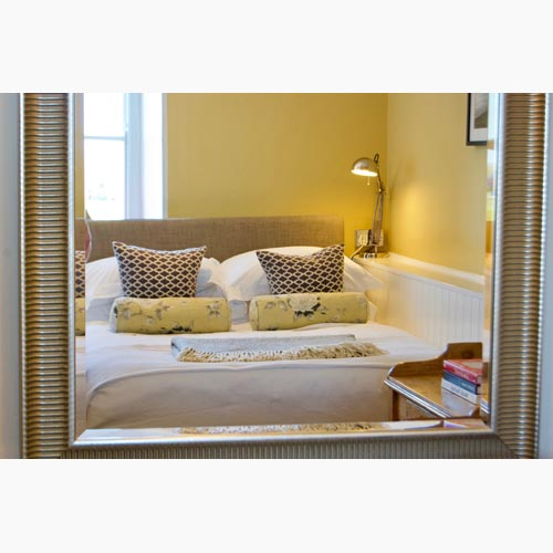 Bedroom relected in mirror